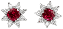 Ruby earrings with diamonds set in a halo setting design in platinum